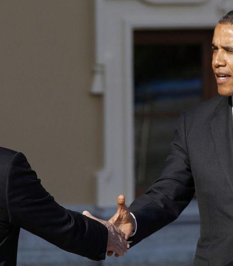 Poutine accueille Obama par une poignée de mains