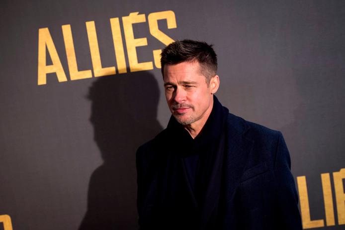Brad Pitt arrives.