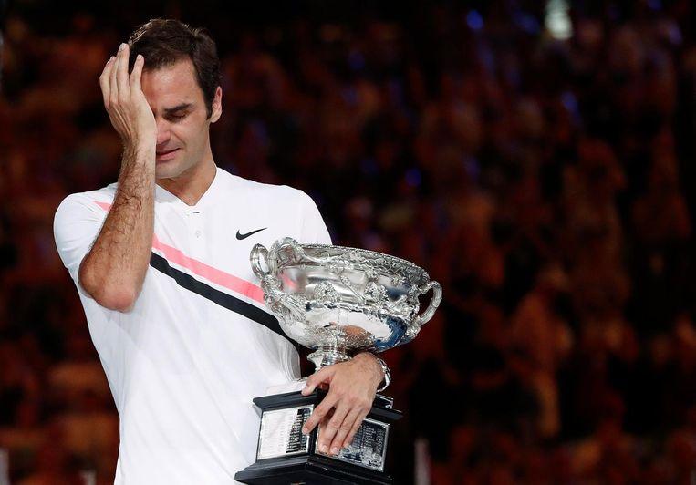 Een emotionele Roger Federer na het behalen van zijn twintigste Grand Slam-titel Beeld reuters