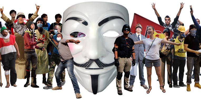 Demonstranten met het iconische Guy Fawkes masker. Beeld Hilde Harshagen