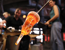Glass furnace. Man holding a red-hot glass. Glasblazen.