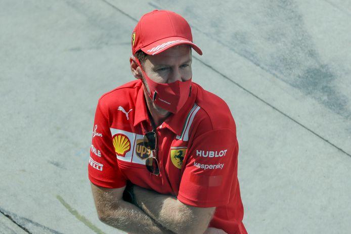 Sebastian Vettel op beeld voor de race in Monza. Later viel hij uit.  ,,Misschien was het voor ons maar beter dat er geen fans waren.''