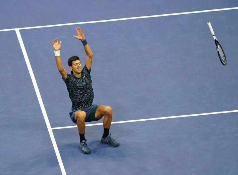 Novak Djokovic viert zijn zege op de Argentijn Juan Martin del Potro in de finale van de US Open. Beeld null