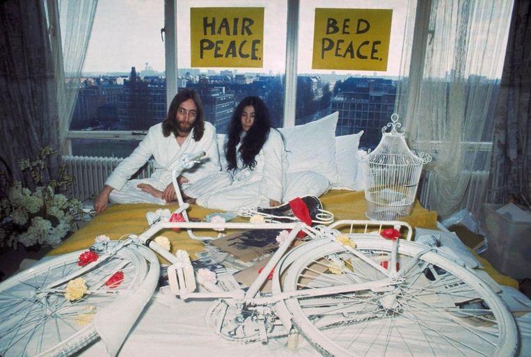 John Lennon en Yoko Ono. Beeld anp
