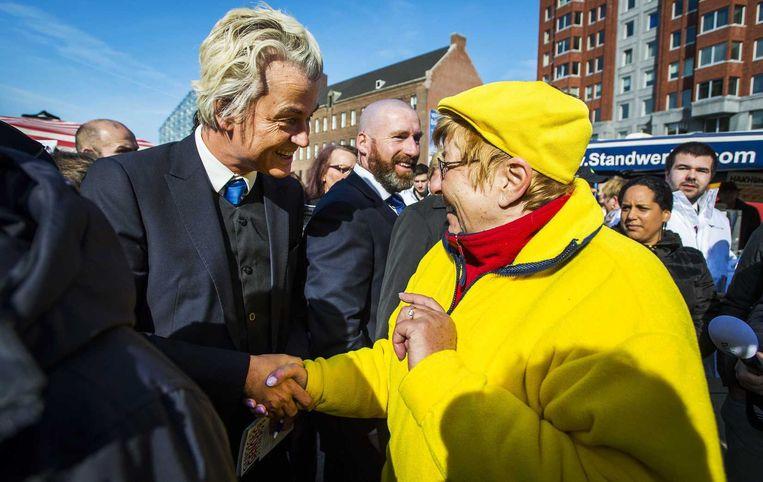 Wilders deelde bij de Markthal flyers uit. Beeld anp