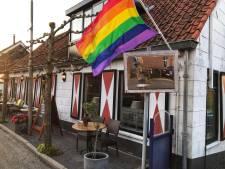 Run op Regenboogvlaggen voor Coming Out Day in Hoeksche Waard