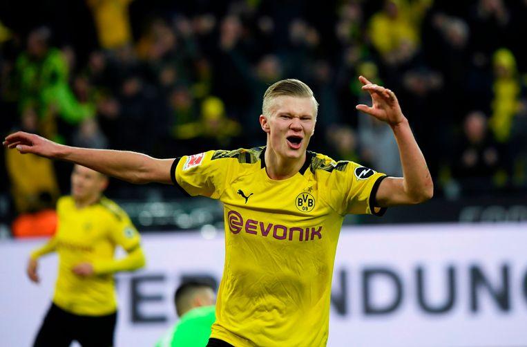 Erling Braut Haaland viert een van zijn doelpunten voor Borussia Dortmund tegen Union Berlin.  Beeld AFP