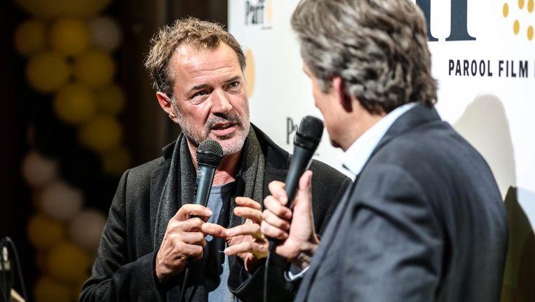 Acteur Sebastian Koch in gesprek met Ronald Ockhuysen, hoofdredacteur van Het Parool Beeld Eva Plevier