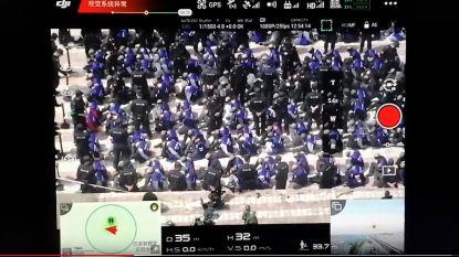 Zorgwekkende videobeelden tonen hoe honderden geblinddoekte mannen worden afgevoerd in China