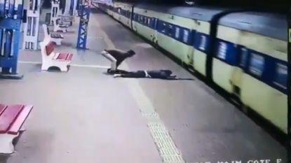 Politieagent redt man van onder voorbijrazende trein