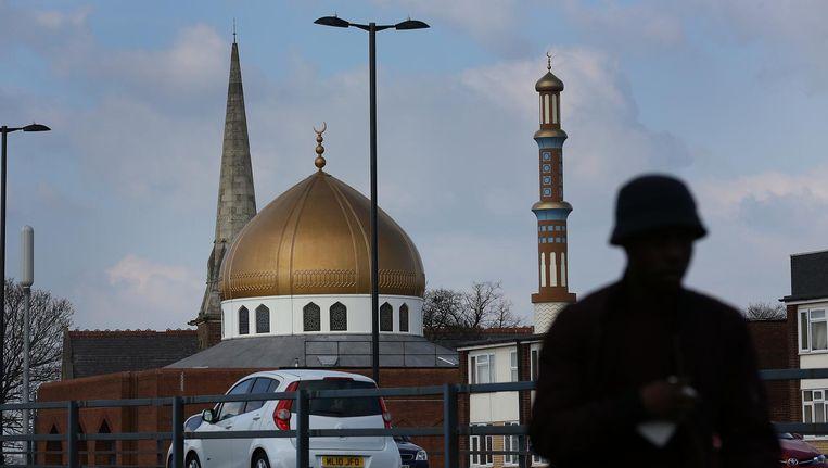 Moskee en kerk naast elkaar in Birmingham, Engeland. Beeld getty