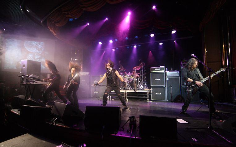 De Heavy metal band Moonspell tijdens een optreden op een cruiseschip op de Caribische Zee. Beeld EPA