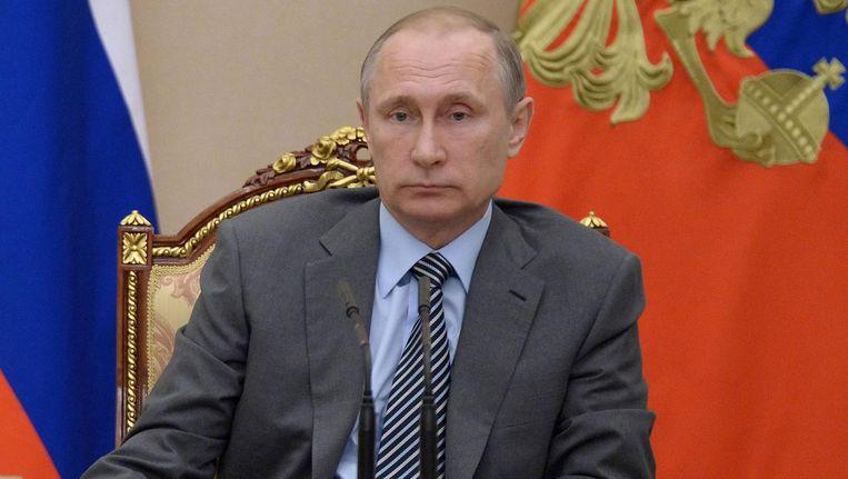 De Russische president Vladimir Poetin tijdens een vergadering over het aanstellen van een anti-doping commissie. Beeld anp