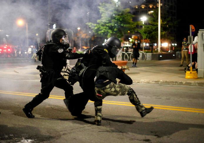Police clash with protesters in downtown Des Moines, I.O., Saturday, May 30, 2020. The protests were sparked in the country by the death of George Floyd, a black man who died in police custody in Minneapolis on May 25. (Bryon Houlgrave/The Des Moines Register via AP)