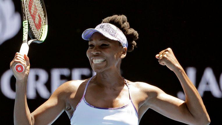 Venus Williams viert haar overwinning. Beeld ap