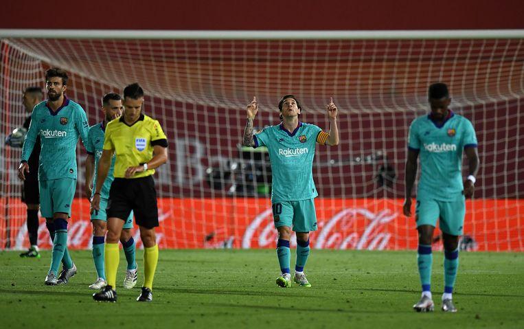 Lionel Messi van FC Barcelona na het scoren van zijn vierde goal tijdens de wedstrijd tegen RCD Mallorca. Beeld Getty Images