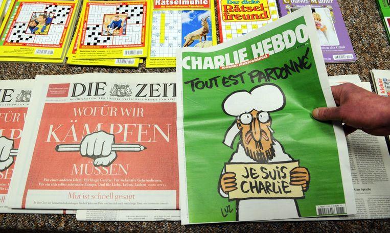De nieuwste Charlie Hebdo in een tijdschriftenwinkel in Duitsland. Beeld epa