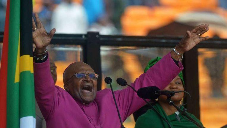 Desmond Tutu tijdens de herdenkingsdienst voor Nelson Mandela. Beeld afp