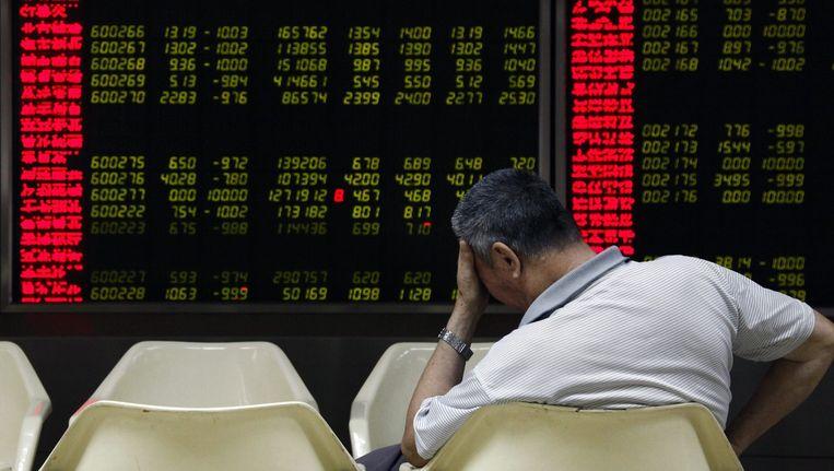 Zorgen om de vrije val van de Chinese beurzen. Beeld anp