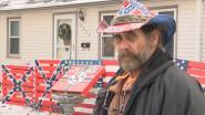 Buurman hangt racistische symbolen naast gekleurd schooltje