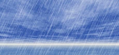 Regenbui slaat gaten in duinen van Cadzand-Bad