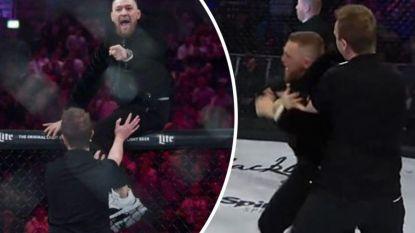 Stoppen slaan vollédig door bij McGregor: Ier springt over kooi na winst van zijn maatje en krijgt het aan de stok met alles en iedereen