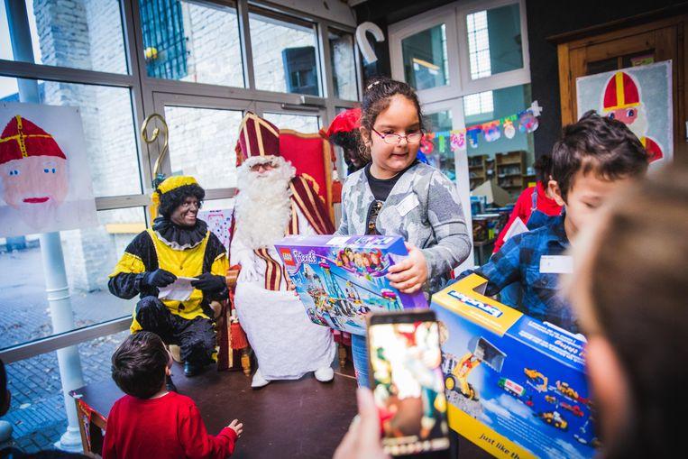 Sinterklaas en Roetpiet op bezoek in de Muze.