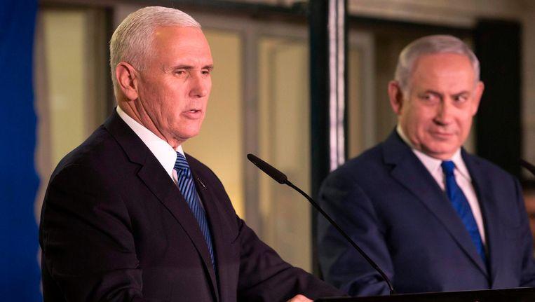 Vicepremier Mike Pence hield een toespraak in het Israëlische parlement. Naast hem premier Netanyahu. Beeld afp