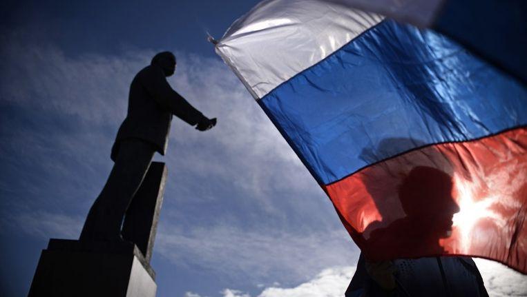 Russische vlag op het Leninplein in Simferopol op de Krim. Beeld anp