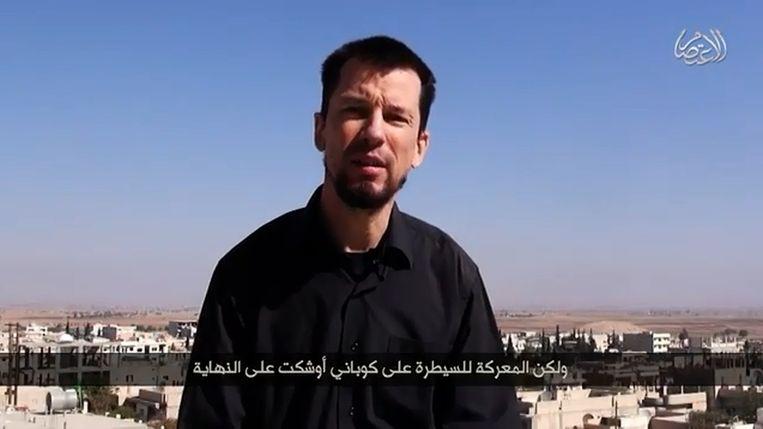 Still uit de recentste IS-video met de Brit John Cantlie. Beeld YouTube