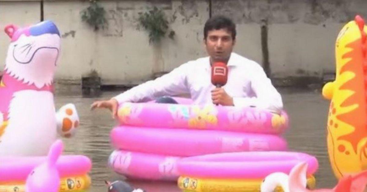 Voorkeur Reporter doet verslag van overstroomde stad vanuit roze ZH29
