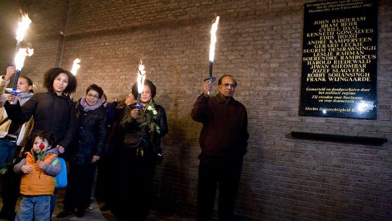 Herdenking van de slachtoffers van de Decembermoorden in Amsterdam in 2009. Beeld ANP