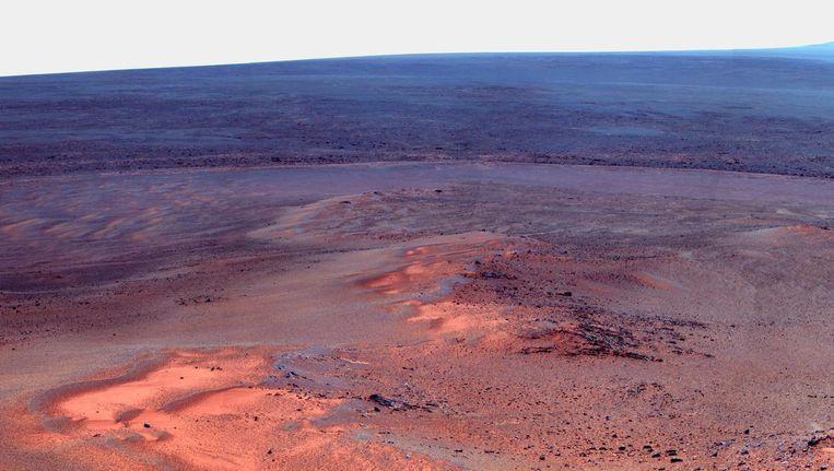 Een foto van het oppervlakte van Mars. Beeld EPA