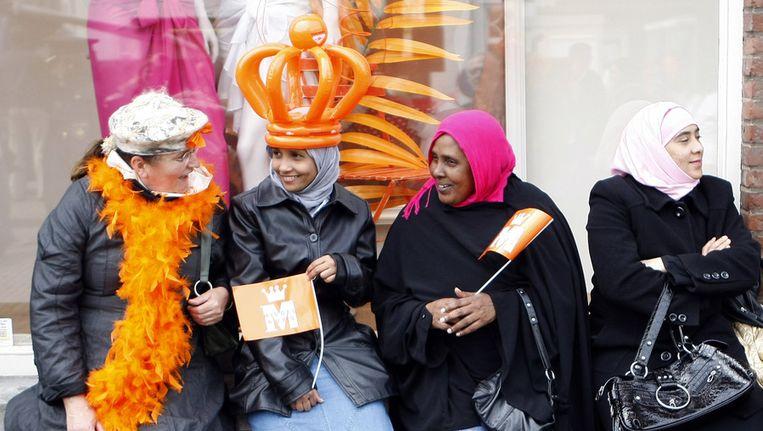 Publiek tijdens de viering van Koninginnedag in Middelburg. Beeld ANP