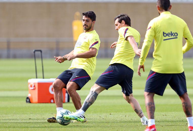 Suárez en Messi op de training bij FC Barcelona.