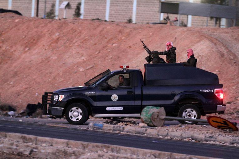 Jordaanse bewakers bij de gevangenis.