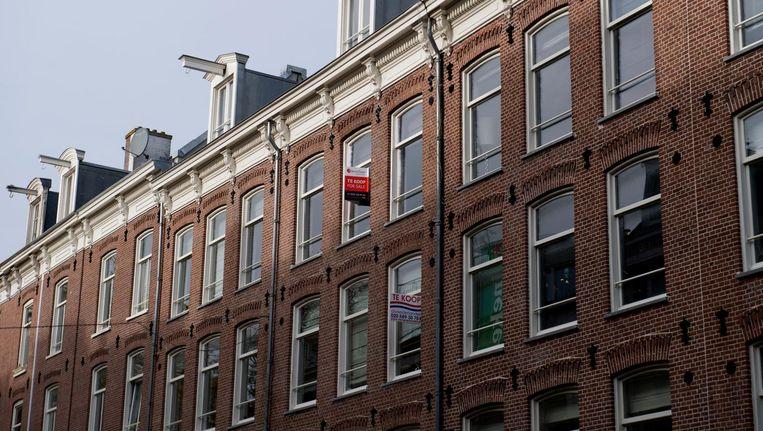 In Amsterdam werden in 2017 relatief minder woningen verkocht dan tijdens de vorige hausse op de woningmarkt, in 2007. Dat ligt niet aan een gebrek aan vraag, maar aan te weinig aanbod. Beeld anp
