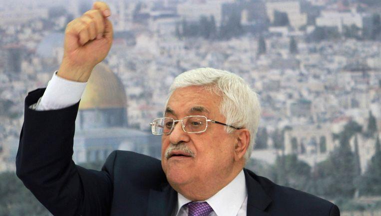 President van de Palestijnse Autoriteit Mahmoud Abbas tijdens een bijeenkomst in Ramallah, op de achtergrond een afbeelding van de Oude Stad van Jeruzalem. Beeld ap