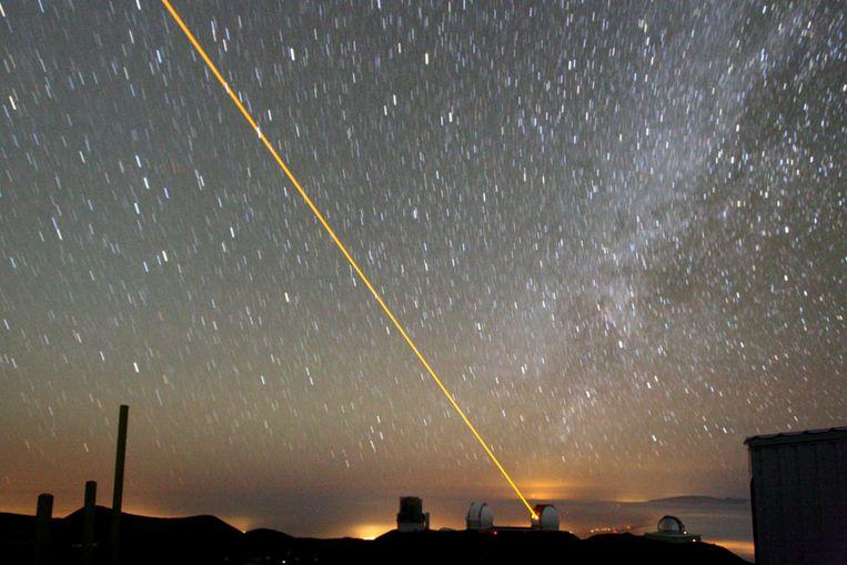 Laserstraal (Foto Paul Hirst / Creative Commons) Beeld