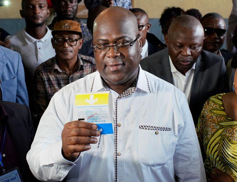 Felix Tshisekedi stemt op 30 december in de Congolese hoofdstad Kinshasa.  Beeld AP