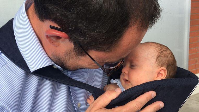 Vincent Van Quickenborne met zoontje Scott